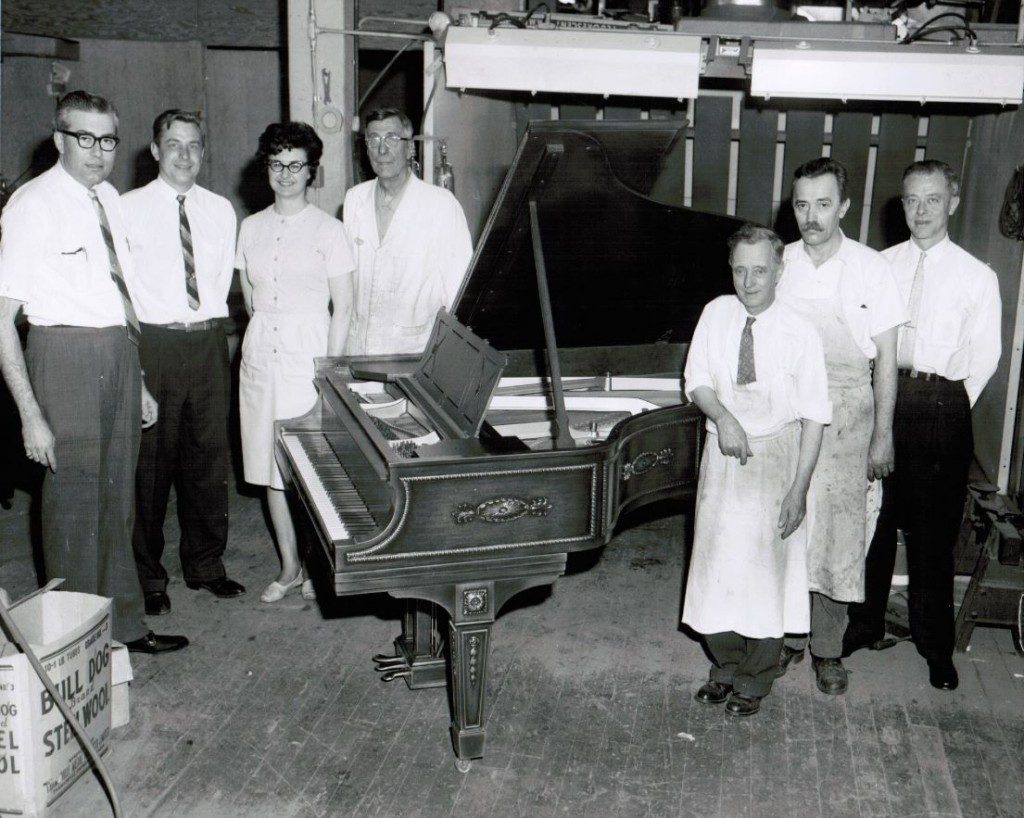 Old black and white photo of staff and old piano